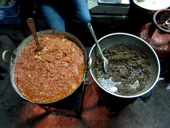 gallons of gajar and roasted semolina Halwa being cooked on the street