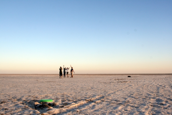 Playing frisbee in the white desert